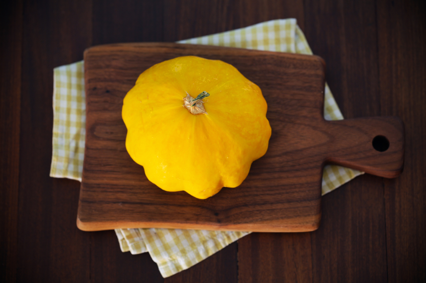 Yellow squash on cutting board