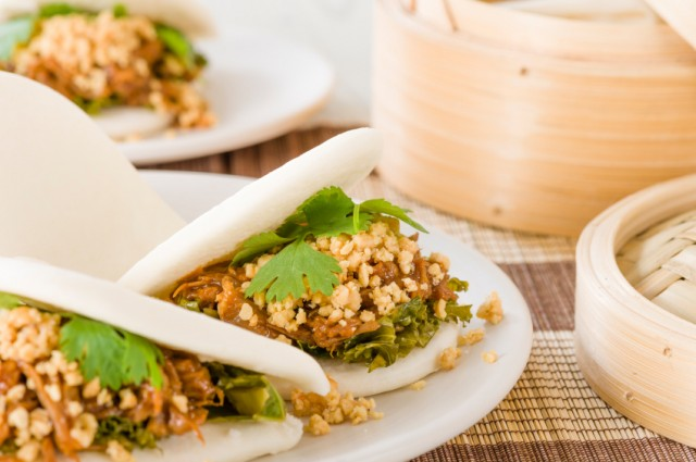 braised pork belly with pickled mustard greens, coriander and crushed peanuts in steamed buns