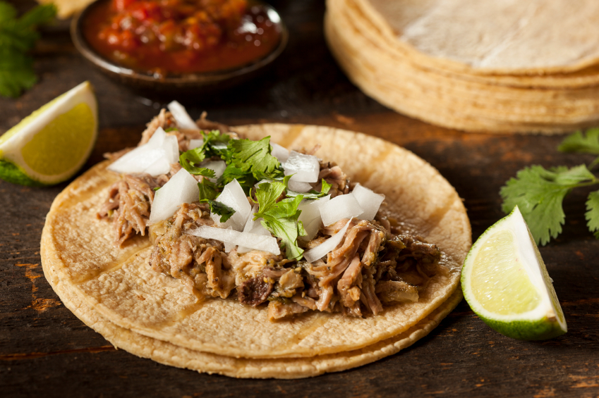 Shredded pork with onions on a tortilla