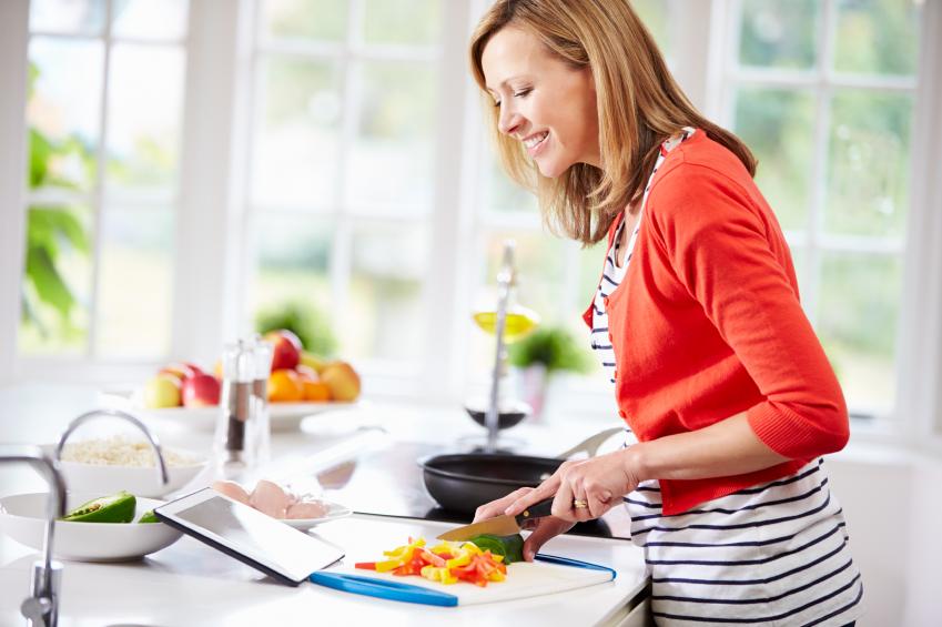 Woman cooking breakfast