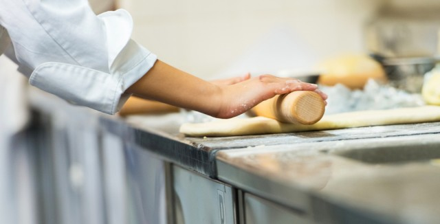 rolling out dough to make a crescent roll dinner