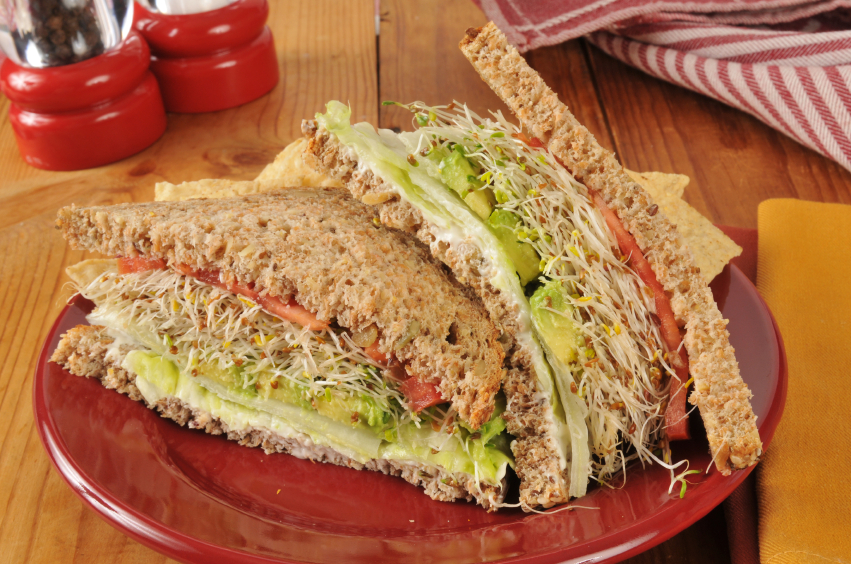 Vegetable sandwich with lettuce, avocado, tomato, and sprouts