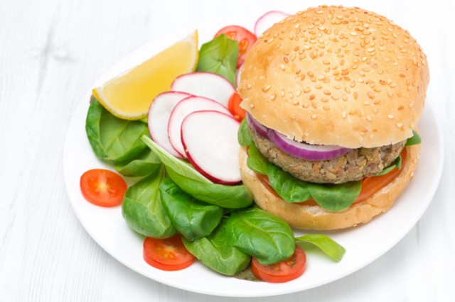 A vegetarian meal with a veggie burger and salad