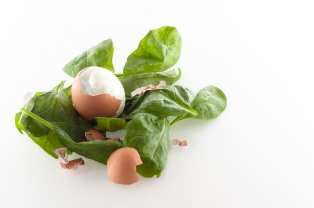 Cracked egg on Spinach