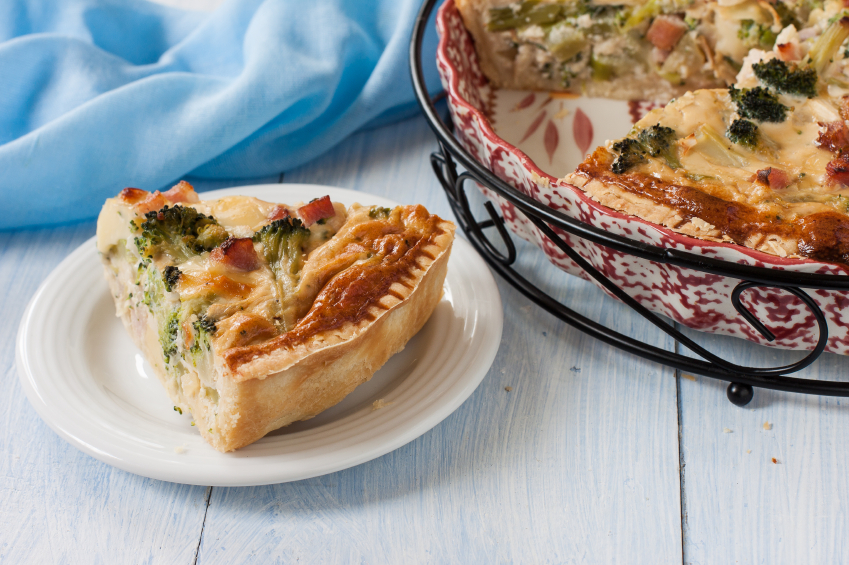 Quiche with slice on plate