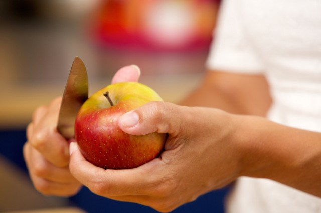Slicing apple with knife