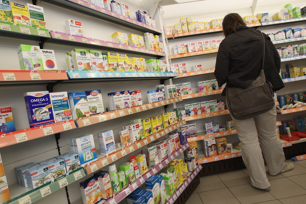 A woman shops at a pharmacy