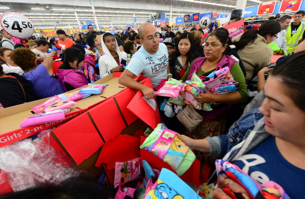 People get an early start on Black Friday shopping deals at a Walmart Superstore on November 22, 2012 in Rosemead, California, as many retailers stayed opened during the Thanksgiving celebrations, evidence that even this cherished American family holiday is falling prey to the forces of commerce. | Photo by Frederic J. Brown/AFP/Getty Images