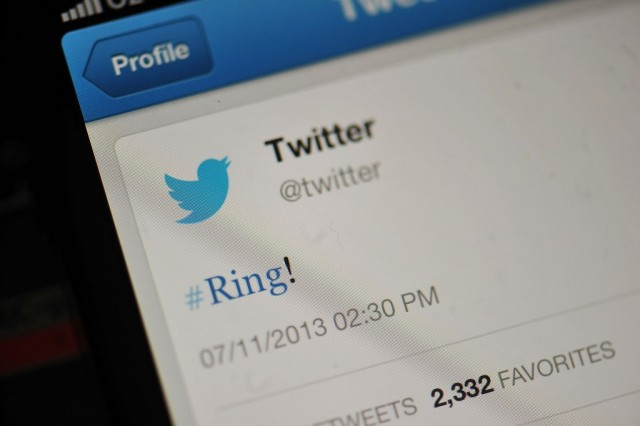 The Twitter logo and hashtag '#Ring!' is displayed on a mobile device as the company announced its initial public offering and debut on the New York Stock Exchange on November 7, 2013