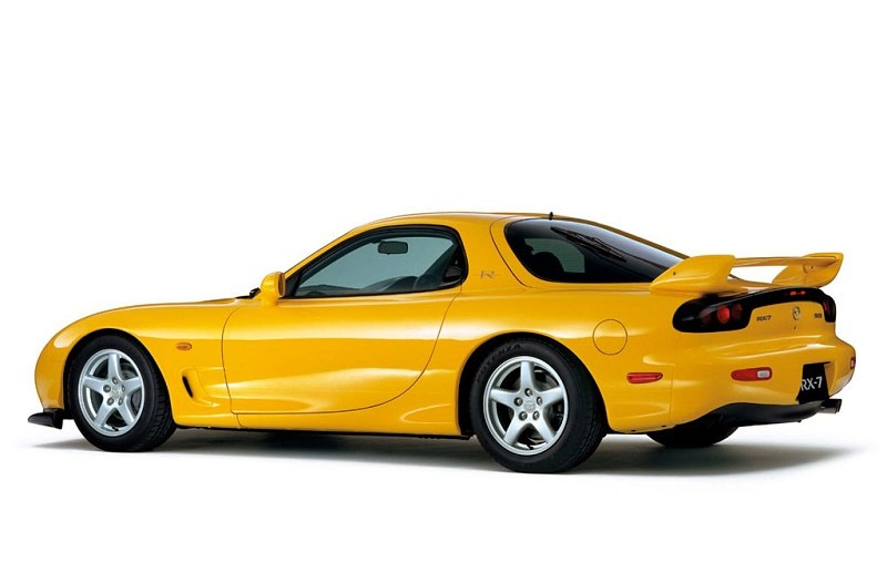 A yellow 2001 Mazda RX-7 Type-R
