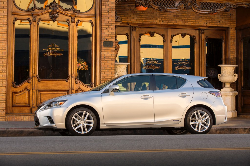 Side view of silver Lexus CT200h on city street