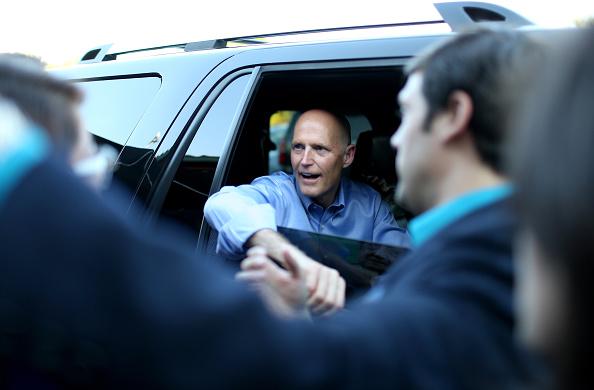 Florida governor Rick Scott shakes hands
