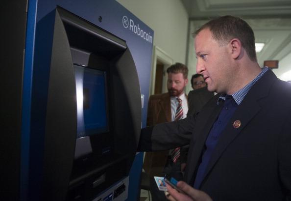 Jared Polis uses a bitcoin ATM