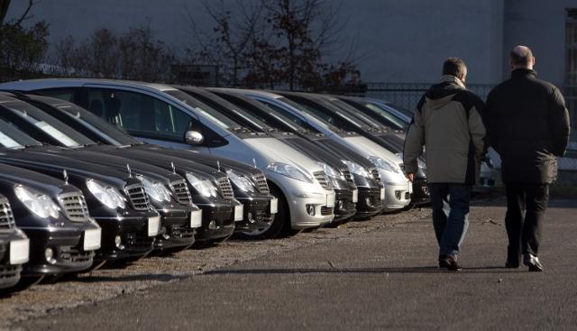 men in car lot