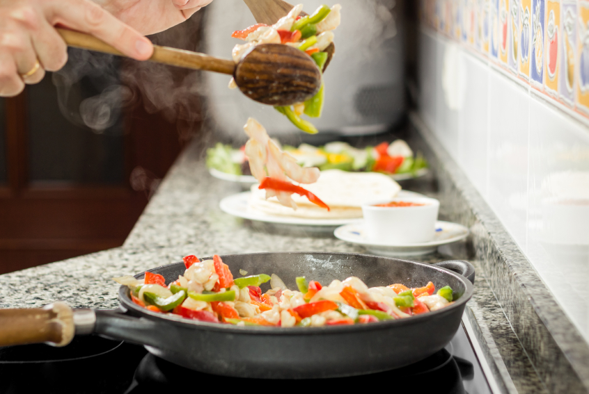 Cooking vegetables and chicken in a pan