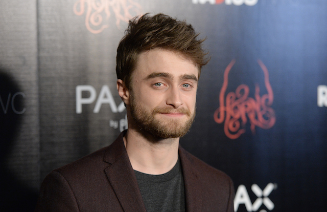Daniel Radcliffe poses on the red carpet at the Horns premiere