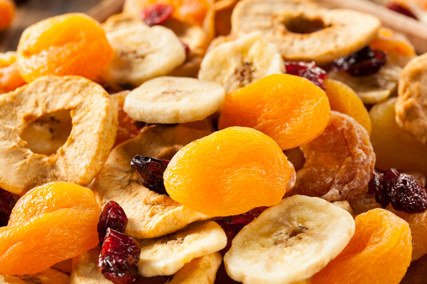 An assortment of dried fruit including apple rings, apricots, cranberries, and bananas