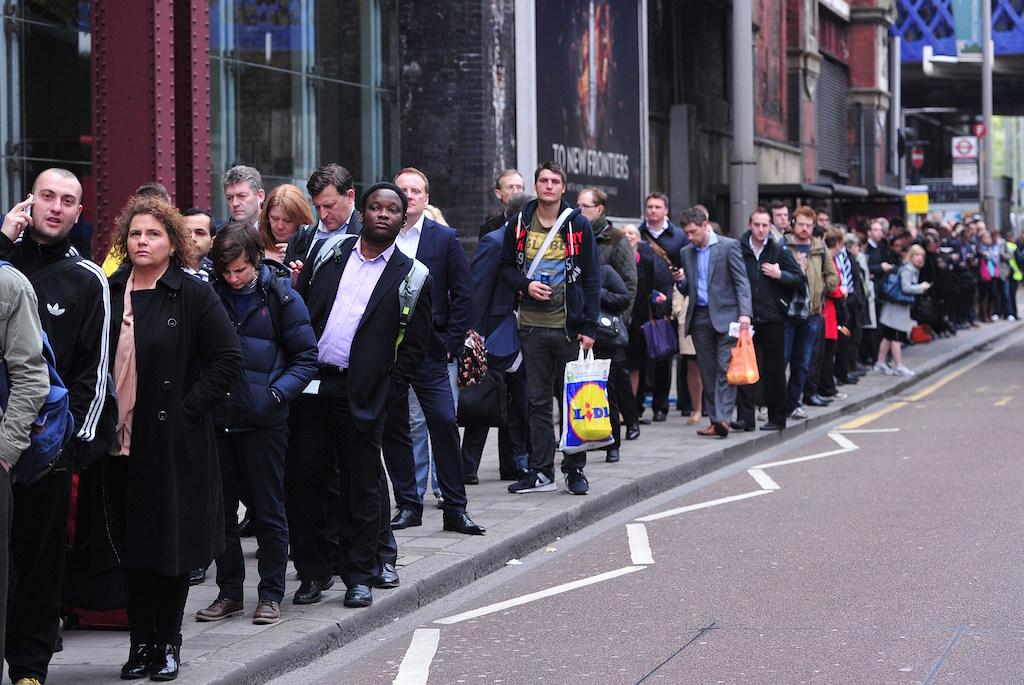 People waiting in line on the sidewalk