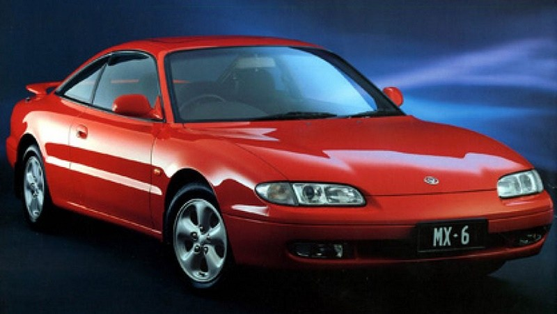 A red Mazda MX-6 from the 1994 model year
