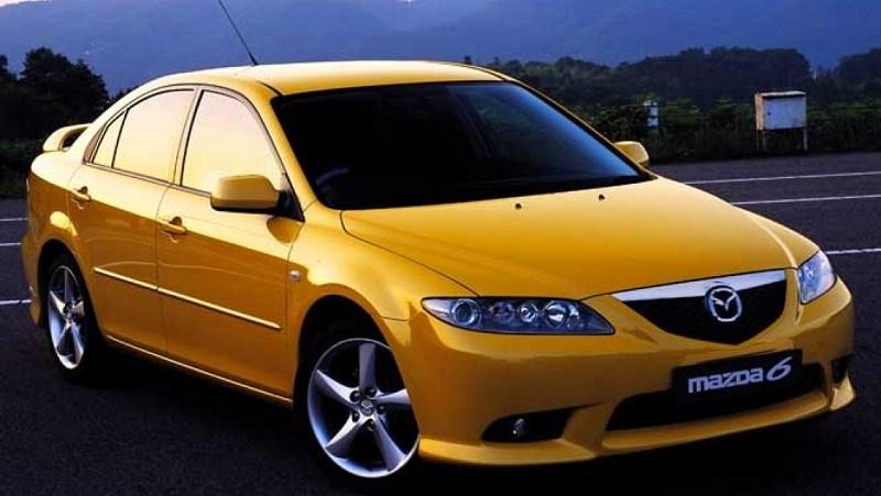 A yellow 2002 Mazda 6