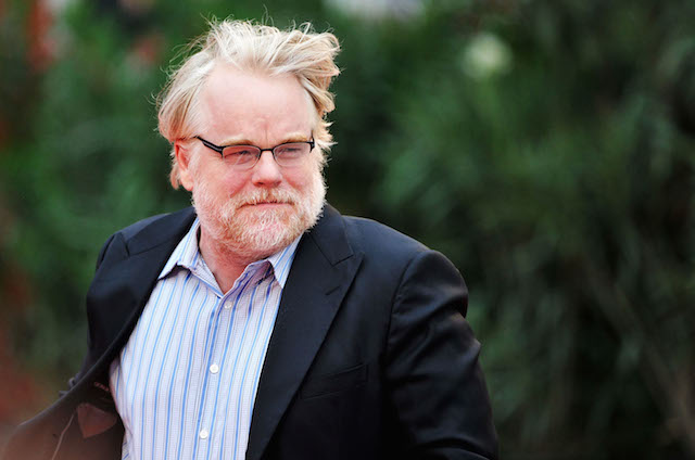 Philip Seymour Hoffman walking outside.