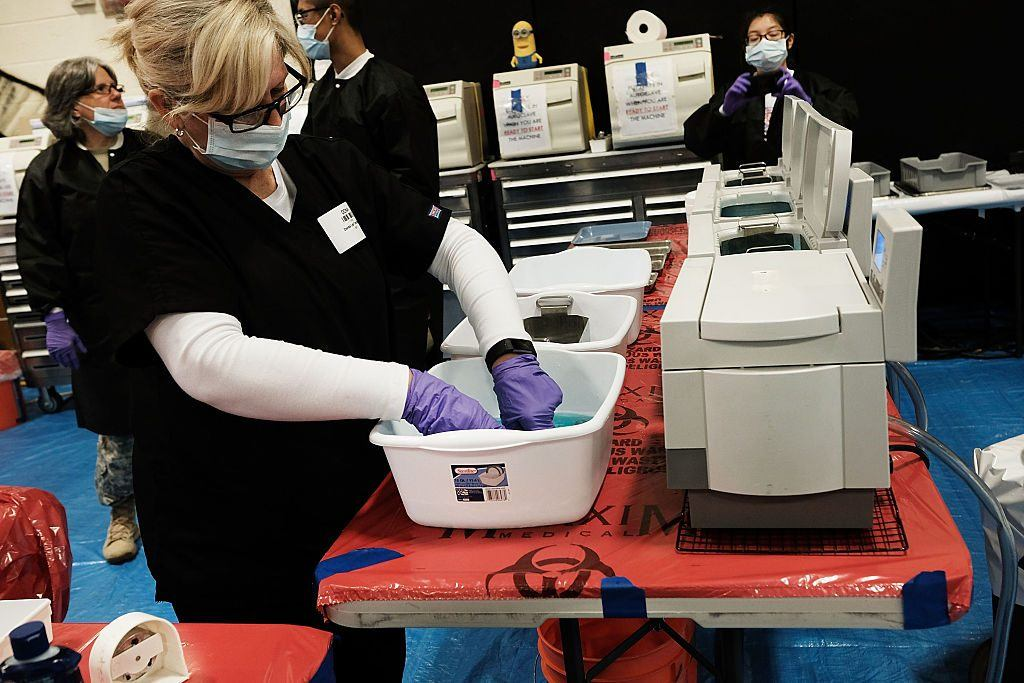 Volunteers sterilize medical supplies at a remote clinic.