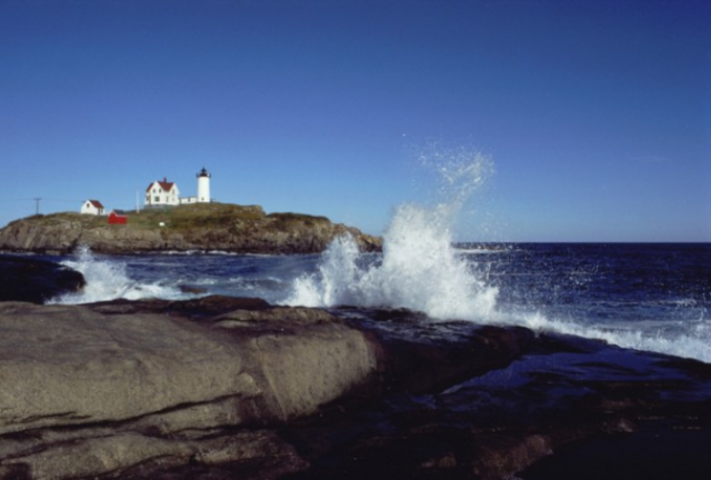 Maine lighthouse on water