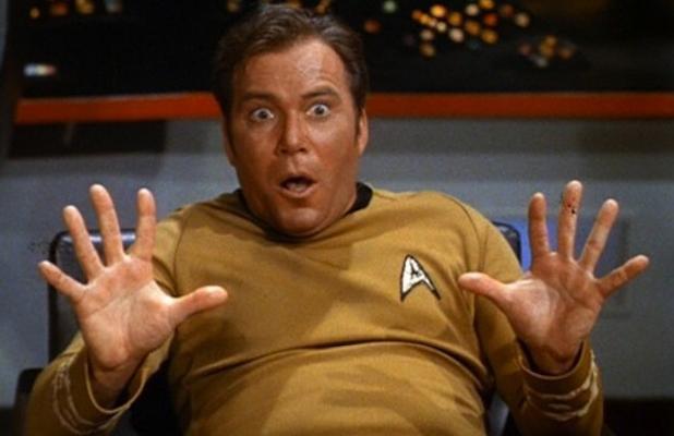 William Shatner as Captain Kirk looking surprised while in uniform