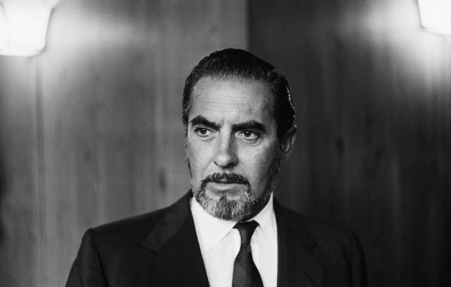 Tyrone Power looking serious in a suit and tie