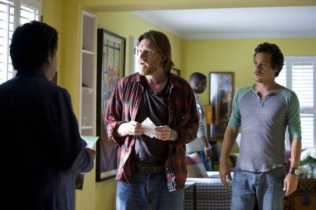 Three men speaking inside a living room in 'Terriers'.