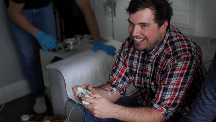 Smiling man playing video game