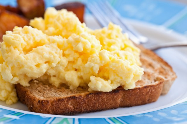 fluffy scrambled eggs on a piece of toast
