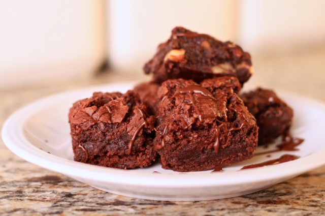 Brownies with chocolate drizzle and nuts