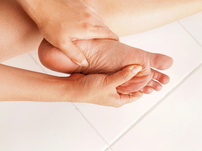 A woman massages her foot