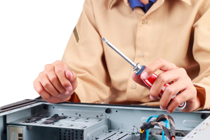 A maintenance worker fixes electronics