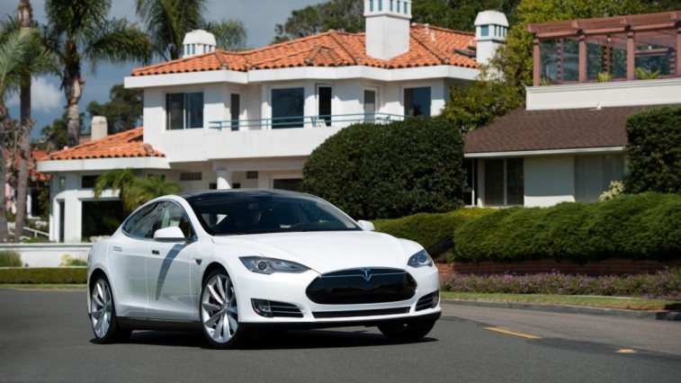 Front three-quarter view of white Tesla Model S from passenger side