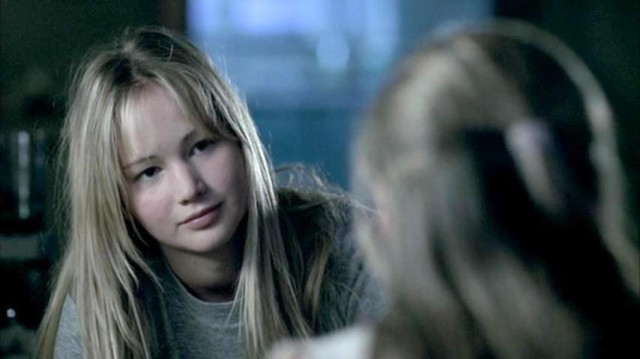 JenniferLawrence looks at a younger girl in The Poker House