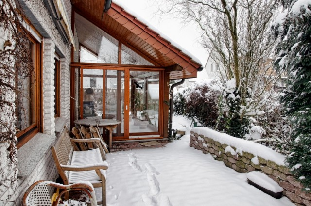 winter-house-snow-patio-sunroom-640x425.jpg