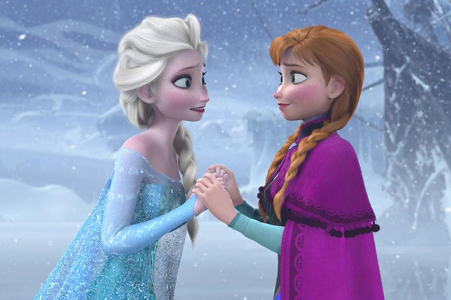 Elsa and Anna hold hands and stand in the snow