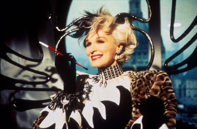 Glenn Close as Cruella de Vil smoking a cigarette and wearing fur in 101 Dalmatians