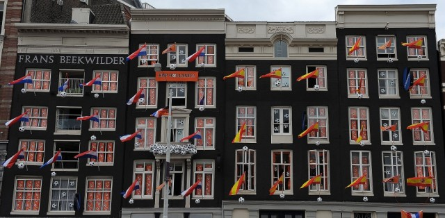 AMSTERDAM, NETHERLANDS - JULY 08: Flags and banners are hung up in windows and on flag poles as Amsterdam prepares for the forthcoming FIFA2010 World Cup Final between Netherlands and Spain, on July 8, 2010 in Amsterdam, Netherlands. (Photo by Christopher Lee/Getty Images)