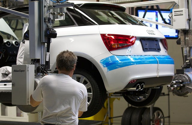 A car mechanic works on the production l