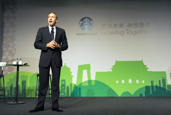 Howard Schultz, president and chief executive officer of Starbucks delivers his speech at the Starbucks Partner Family Forum in Beijing on April 18, 2012. (Photo by Liu Jin/AFP/Getty Images)