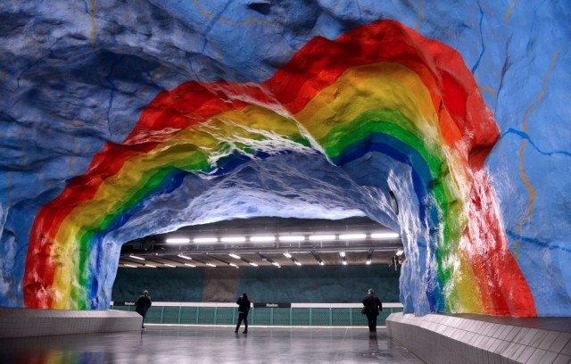 People walk at the Stadion subway station on November 6, 2012 in Stockholm. Over 90 of the 100 subway stations in Stockholm have been decorated with sculptures, mosaics, paintings, installations, engravings and reliefs by over 150 artists. (Photo by Jonathan Nackstrand/AFP/Getty Images)