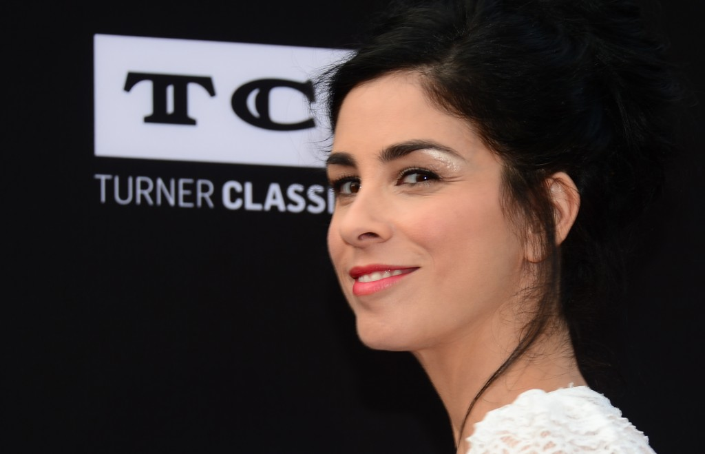 Sarah Silverman is in a white outfit on the red carpet.
