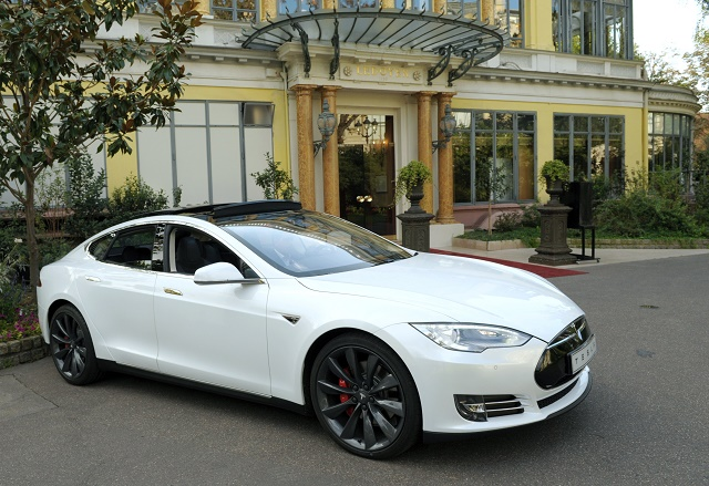 A Model S by US electric car maker Tesla is displayed on September 25, 2014 during a press presentation in Paris. The Paris Motor Show will open to the press on October 2, 2014 and to the public on October 4. (Photo by Eric Piermont/AFP/Getty Images)