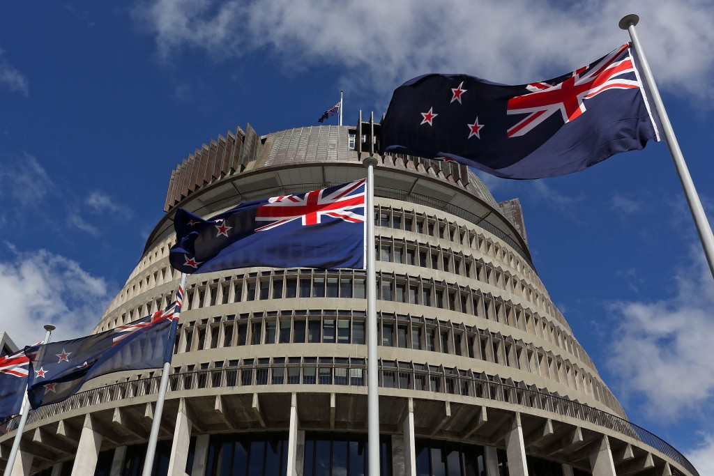 New Zealand flags fly in front of The Beehive.