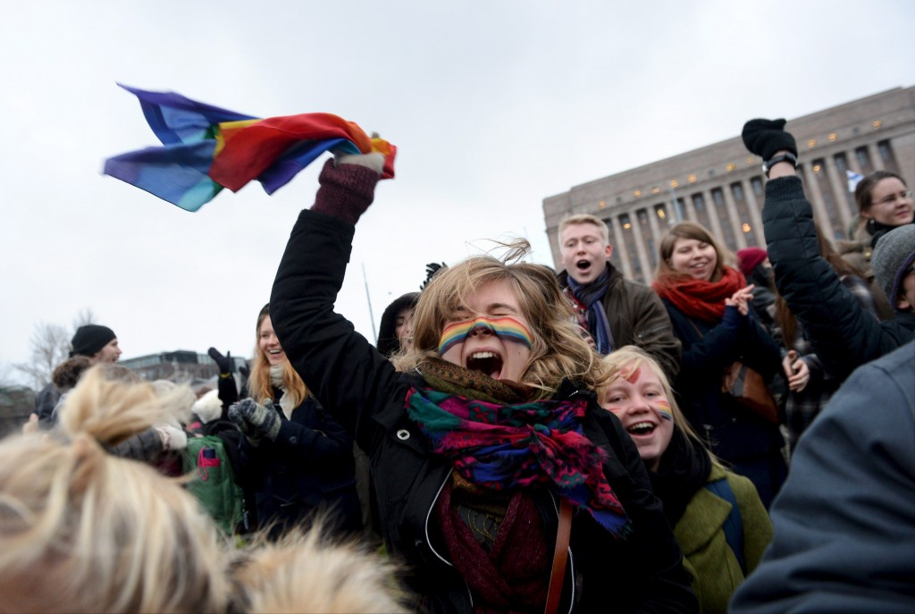 Supporters of the same-sex marriage celebrate outside the Finnish Parliament in Helsinki, Finland on November 28, 2014 after the Finnish parliament approved a bill allowing homosexual marriage. (Photo by Mikko Stig/AFP/Getty Images)