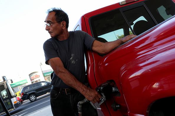 Man pumping gas into his car