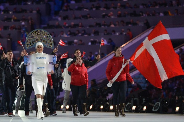 Denmark's flag bearer, curler Lene Nielsen leads his national delegation during the Opening Ceremony of the Sochi Winter Olympics at the Fisht Olympic Stadium on February 7, 2014 in Sochi. (Photo by Alberto Pizzoli/AFP/Getty Images)